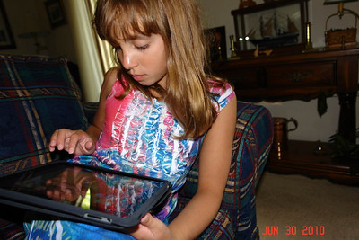 July 30, 2010  Alex using her camera skills on sister