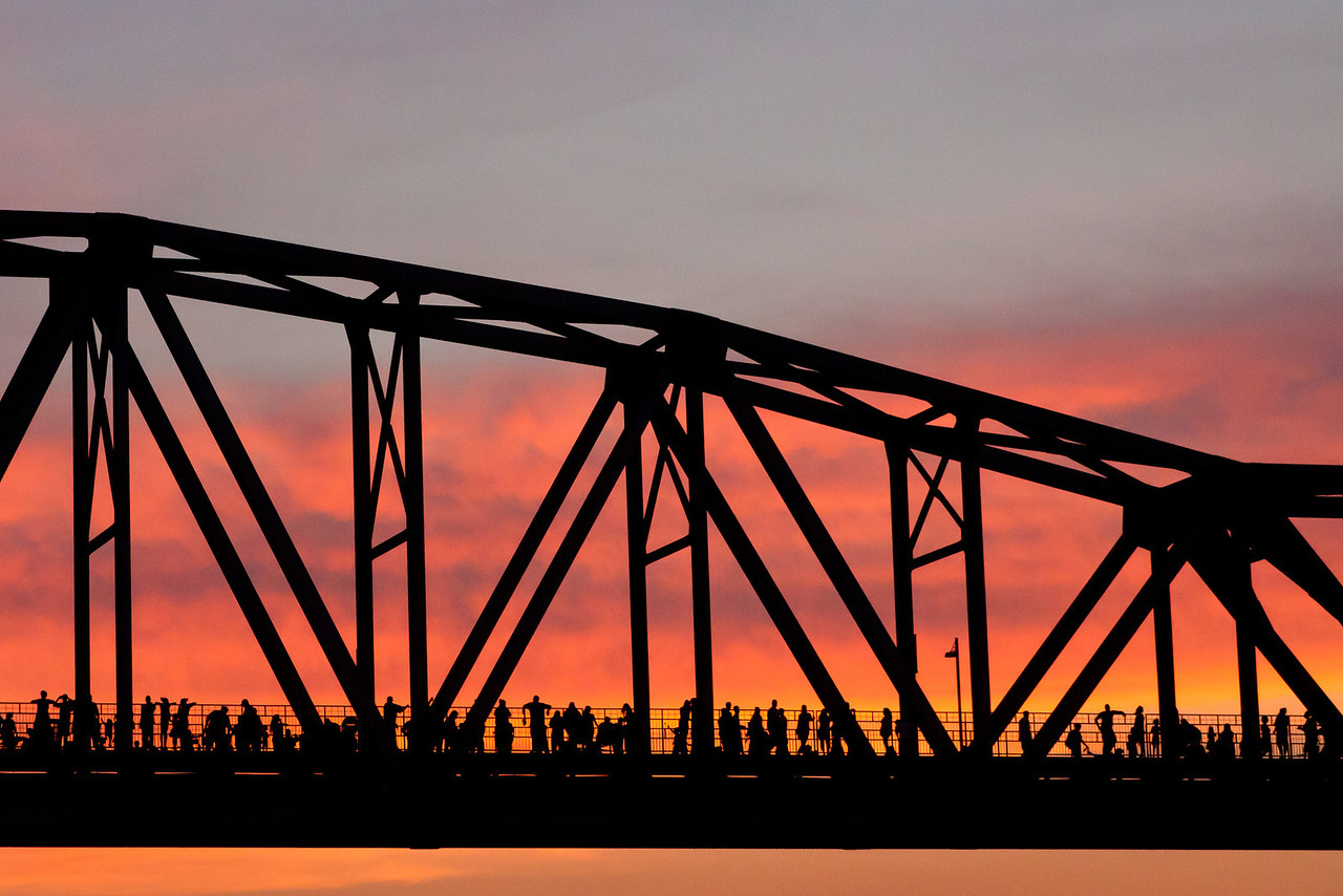 People line a bridge over the Arkansas River waiting to watch the Little Rock 4th of July fireworks show.