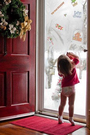 """""""We can't see Santa. Here, let me clean the glass so we can see him!"""""""