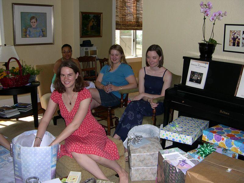 Liz unwrapping presents.