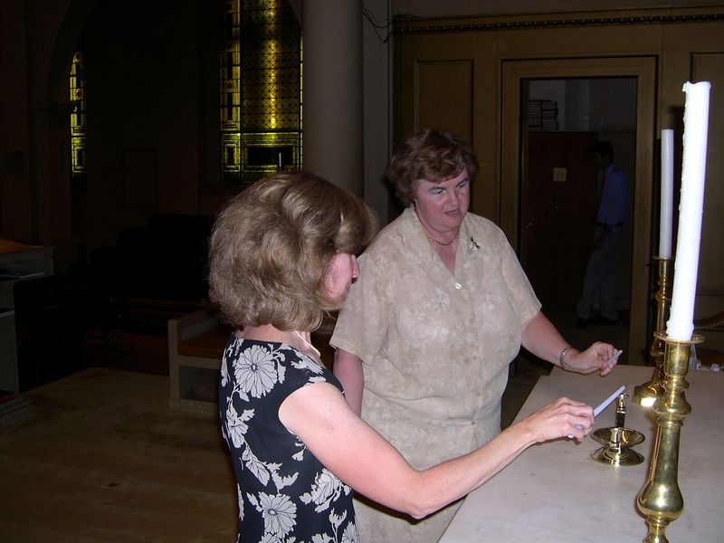 Susan and Mary Jo practice the lighting of the candles for the ceremony.