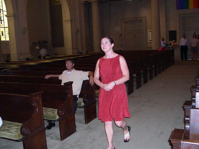 Jen comes down the aisle.