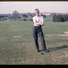 Lloyd Lantz standing by the tee on golf course. 1965 April.
