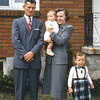 Lloyd, Peter, Helen and Paul Lantz in front of house.