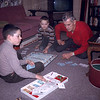 Paul, Peter and Lloyd Lantz playing monopoly in recreation room. 1964.