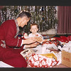 Lloyd and Paul Lantz opening Christmas presents.