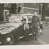 Bill Domm with Llloyd Lantz. Lloyd in army uniform, likely end part of World War II to early 1946. Digital file provided by Bill Domm. Car is a 1941 Chrysler. Photo taken outside 5523 University Avenue South in Chicago.
