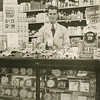 Lloyd Lantz behind the counter in drugstore, Tamblyn's.