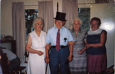 Dad with his sisters Martha, Phyllis, and Emily celebrating his birthday in Wales many years ago
