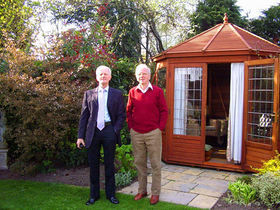 """Lawrence and his brother in front of the """"Summer House."""""""
