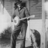 """grandpa_james_harries_taylor"" is Grandpa on the front porch of the old ranch house playing his banjo.  It had to be around  1936 - 1940 I am guessing 'cuz the dog looks like Cap.   I remember the banjo well.  It was a 5-string banjo.  Grandma had it when I was a little boy.  -Jim"