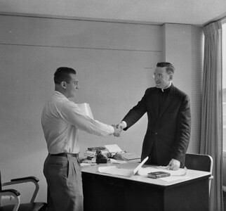 Uncle Sal greeted by dormatory manager in Dormatory at Gannon College Erie PA c. 1958
