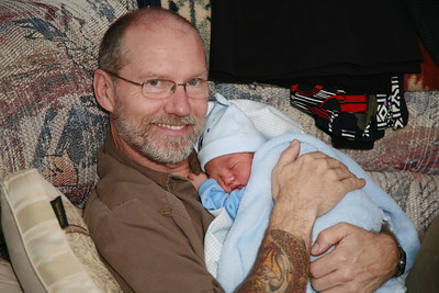 "Grandpa Andy "" GrAndy "" gets to burp Brendon on his first day home."