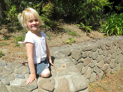 Allegra posing on the stone wall.