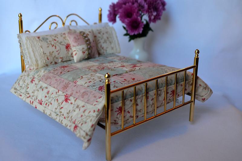 Celeste's handiwork--a miniature bed set sewn for sale on Celeste's Etsy web page.