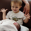 Calvin holding his new sister for the first time