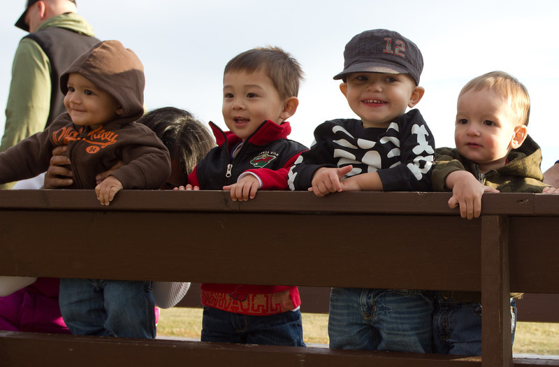 A fall trip to an apple orchard with friends: Jameson, Bryce, Gavin, and Henry.