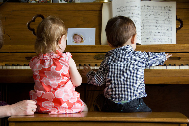 Playing piano at Grandma and Grandpa Ludwig's house with cousin Chloe.