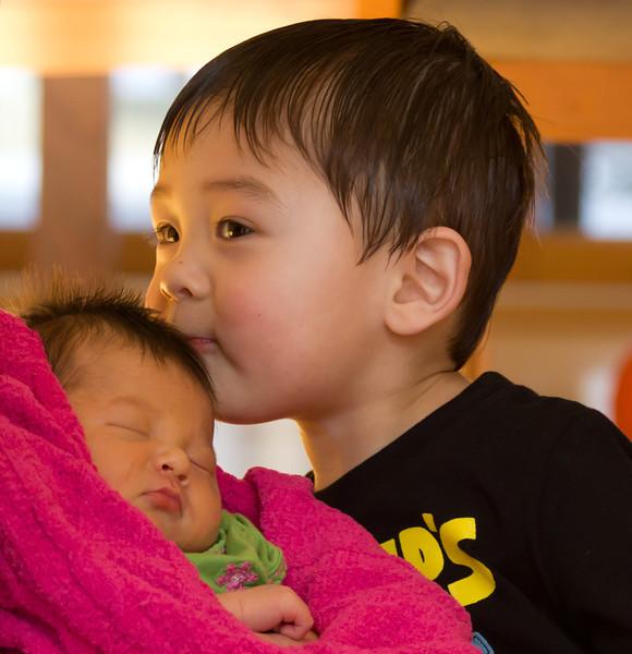 Kissing baby sister.
