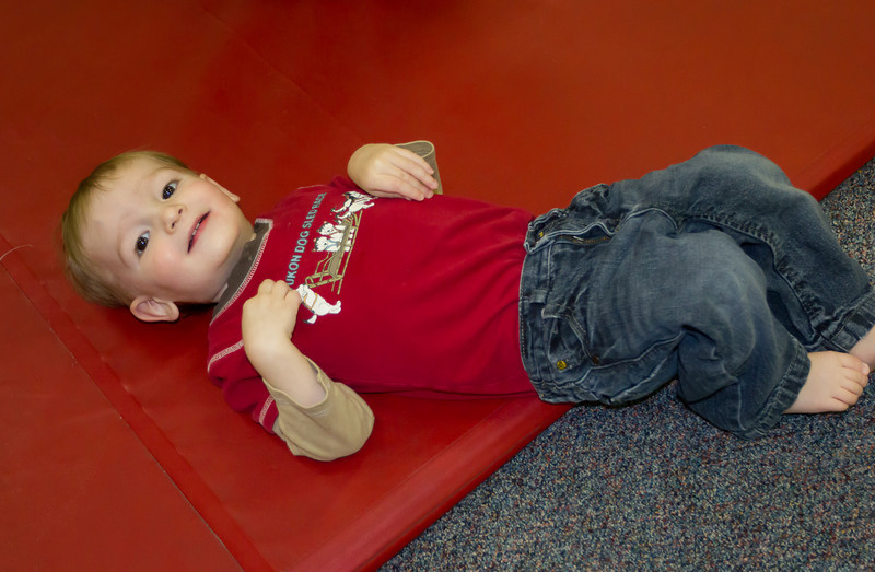 Henry, practicing his tumbling moves at the Little Gym.