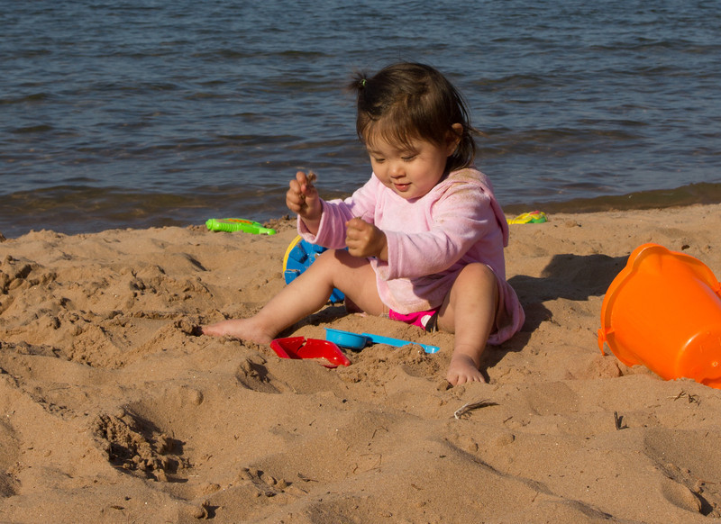 The beach on Madeline Island was perfect sand, super long, and the water was just warm enough to swim in.