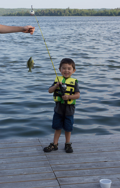 Bryce loved fishing. He learned to cast all by himself and tear worms apart!