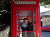 Luke & his dad posing in the phone booth