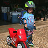 Modeling his new duds.  Helmet, elbow pads, gloves, kneepads, proper shoes.  Just in case of a crash.