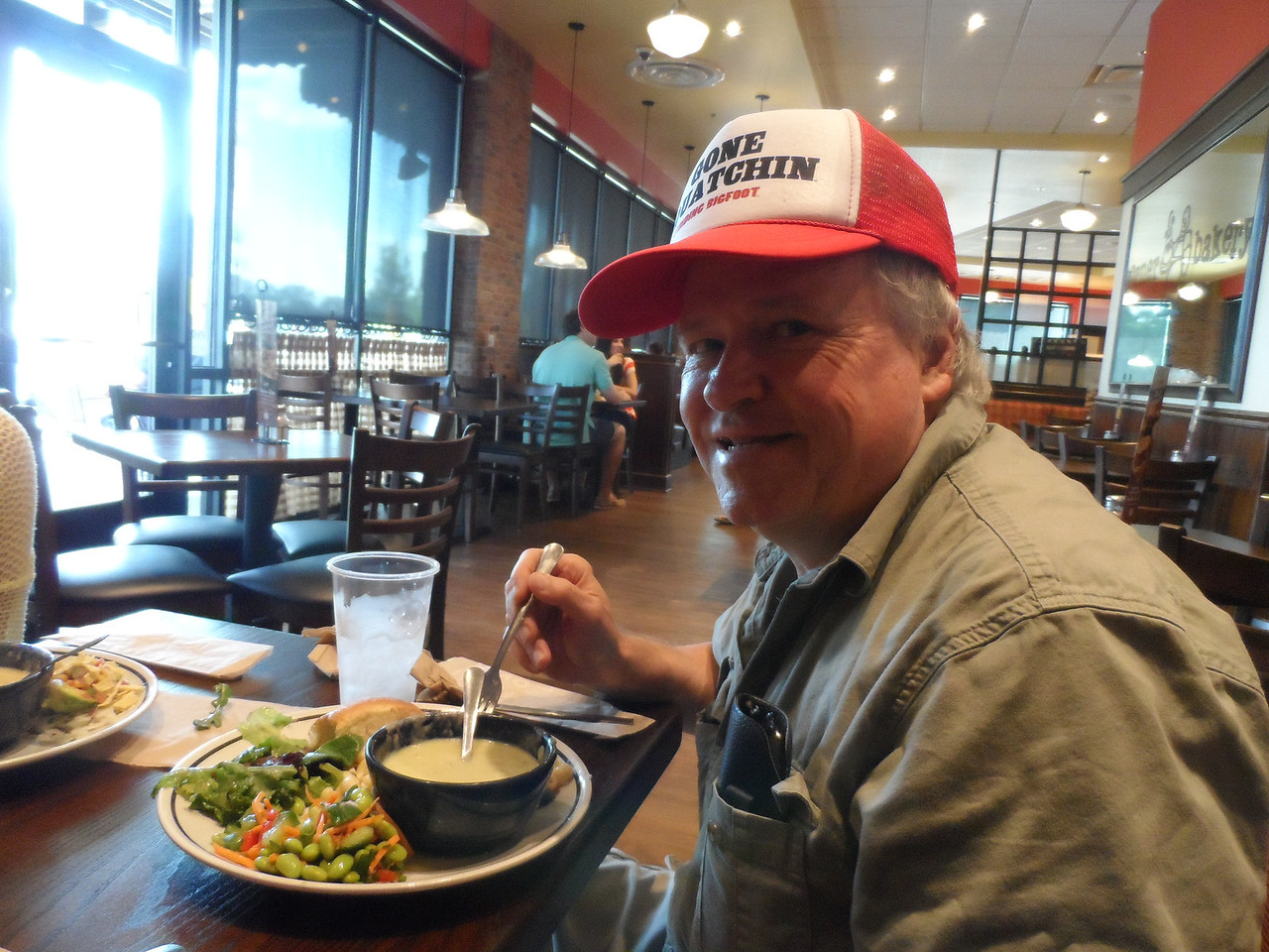 Dad gets ready to get after it at Luke's birthday dinner.  Corner Bakery Cafe.