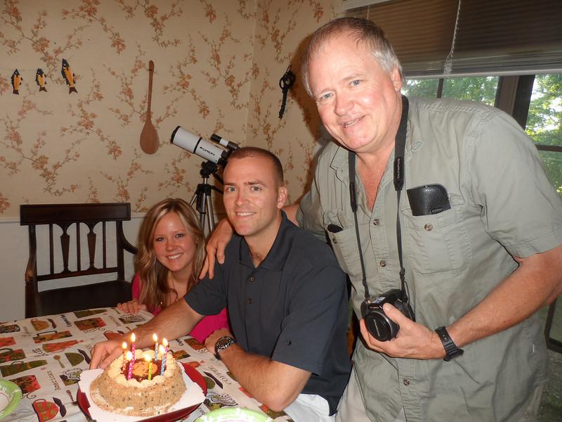 Katie, Luke, and Dad, pose with Luke's ice cream cake.