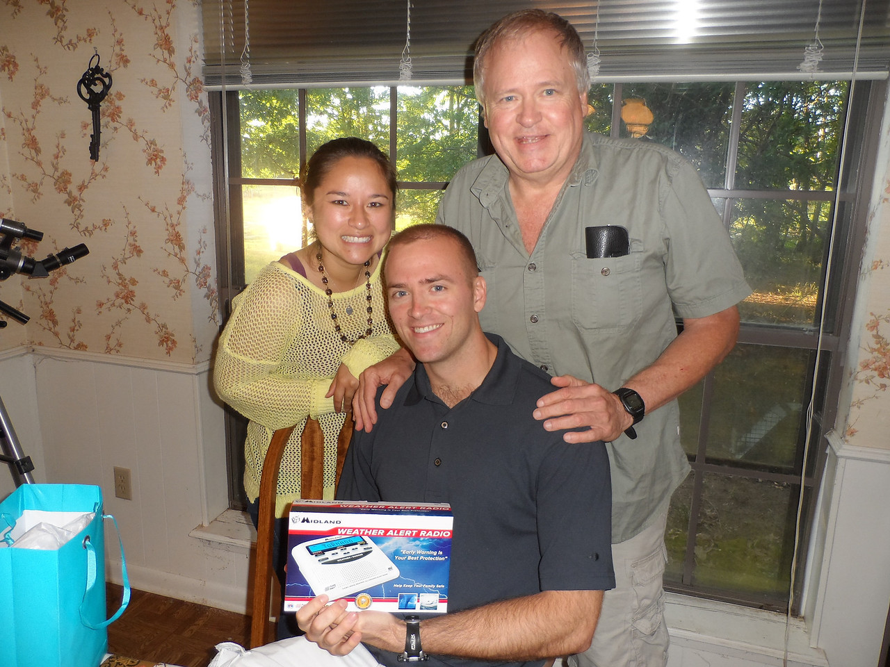 Luke, Tiffany and Dad.  Luke gets a weather alert radio from Dad.