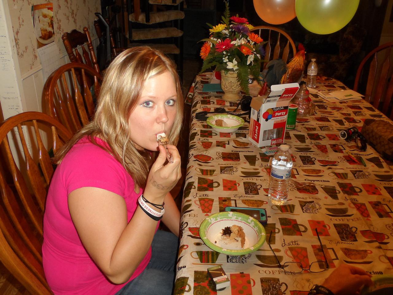 Katie seems to like the ice cream cake also.  Luke's birthday party 2013.