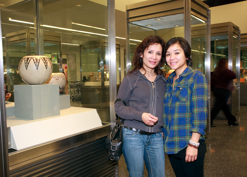 """Dung and Ly. I think Ly was """"pictured out"""" by this time, but Dung insisted on taking this picture next to the display case. ;-)"""