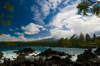 The Ke'anae Peninsula is an isolated and wildly beautiful place where the surf pounds against the jagged lava rocks that edge a gnarly coastline on the Road to Hana