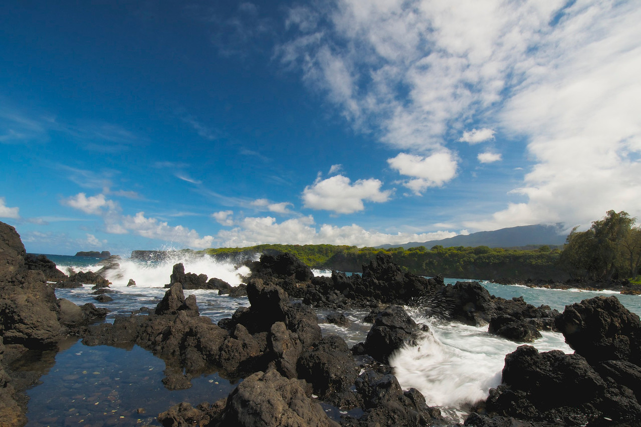 The Ke'anae Peninsula is an isolated and wildly beautiful place where the surf pounds against the jagged lava rocks that edge a gnarly coastline on the Road to Hana. Sally's Banana Bread come from here.