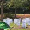 Before the service - a member of the Honor Guard in on a berm above the site, guarding the rifles.