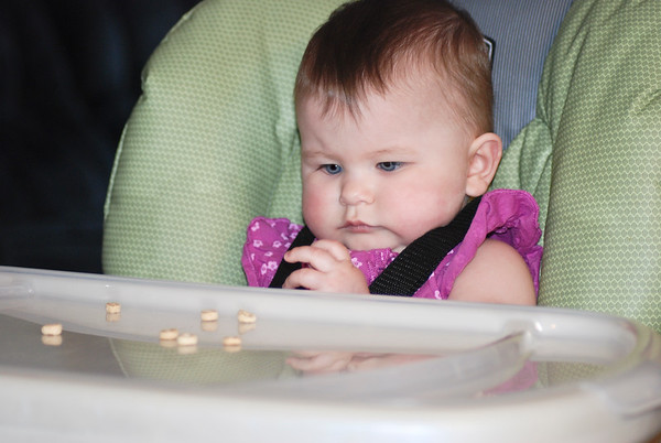 Her First Cheerios.  I couldn't wait for this. I love watching baby's chubby little hands trying to pick up cheerios!
