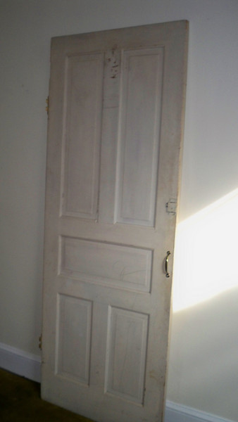Miscellaneous door in middle room - one of many orginal doors that were removed no doubt.  Question is....which one.