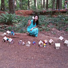 Amy with some of the fairy houses already in the forest.....