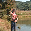 Fall 1974:  Ben, with real fishing rod and fish caught from pond.
