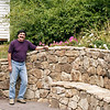 Summer 1997:  Tom Warder with wall and patio he built.