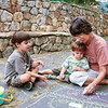 September 2002:  Noah, Sam, Judy, patio art.