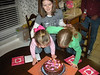 Blowing out the candles.