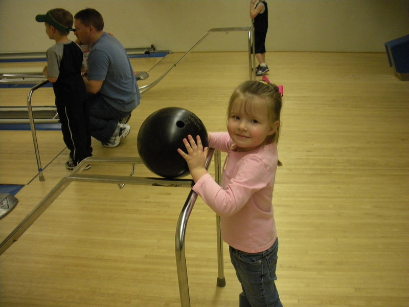 Claire bowling at a birthday party.