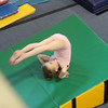 Norah at gymnastics...backwards roll.