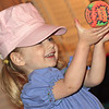 "Cid grabbed her ""baseball cap"" to play catch with daddy. (No, it's really not an engineer's cap!)"
