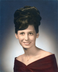 Marcia's high school graduation picture with big hair.