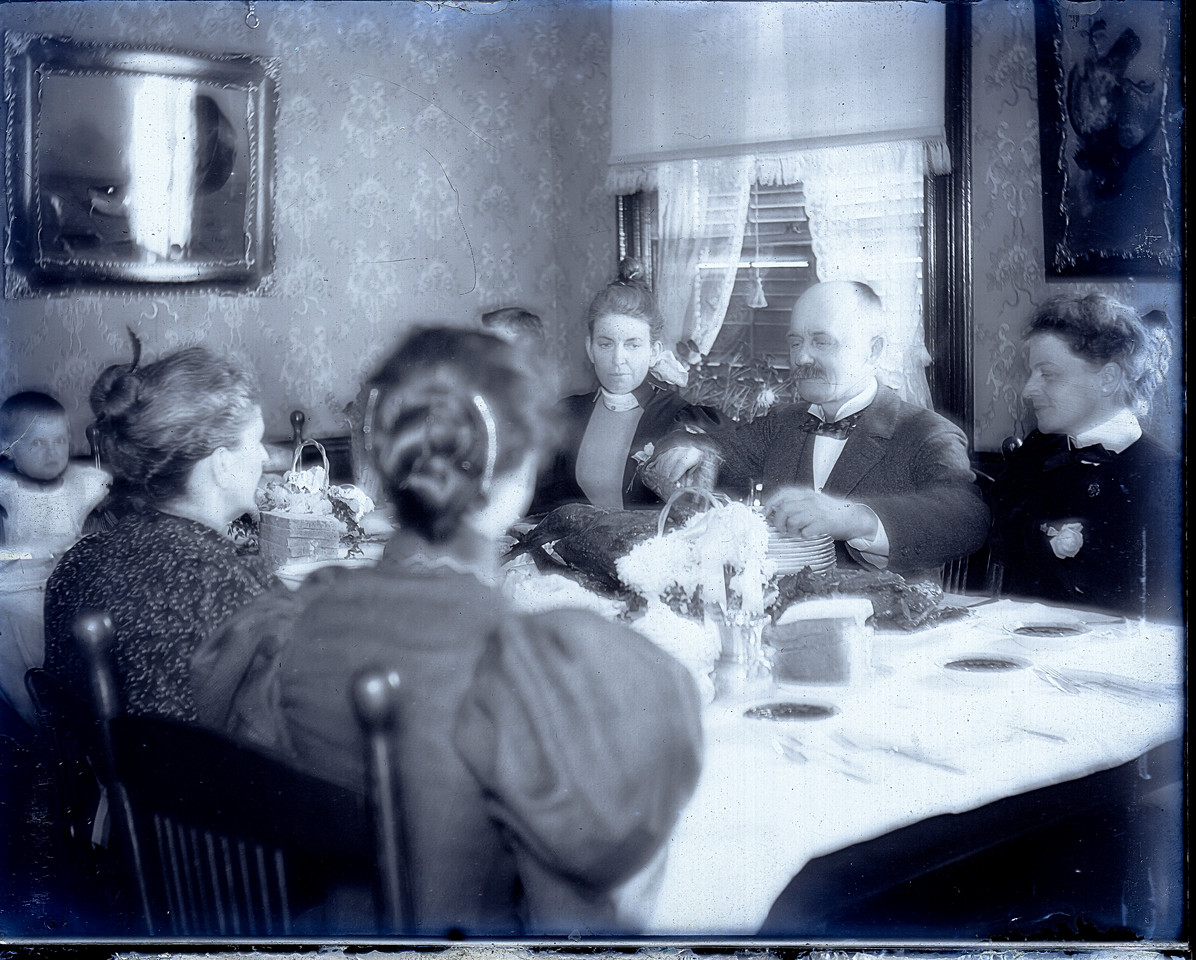 What I can only assume is Thanksgiving or Christmas dinner at Henry Marean's house at 17 Murray Street in Binghamton, NY. I don't know the year of the picture or who all of the people in the picture are.  I'm kind of betting that the woman to the right of Henry is his wife Maria. Note the more salt and pepper look to the moustache in this image compared to the darker moustache in the picture of the sick man.