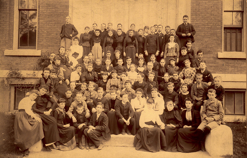 H. Elliott Marean, Sr is in the first row on the far right, sitting on the concrete.