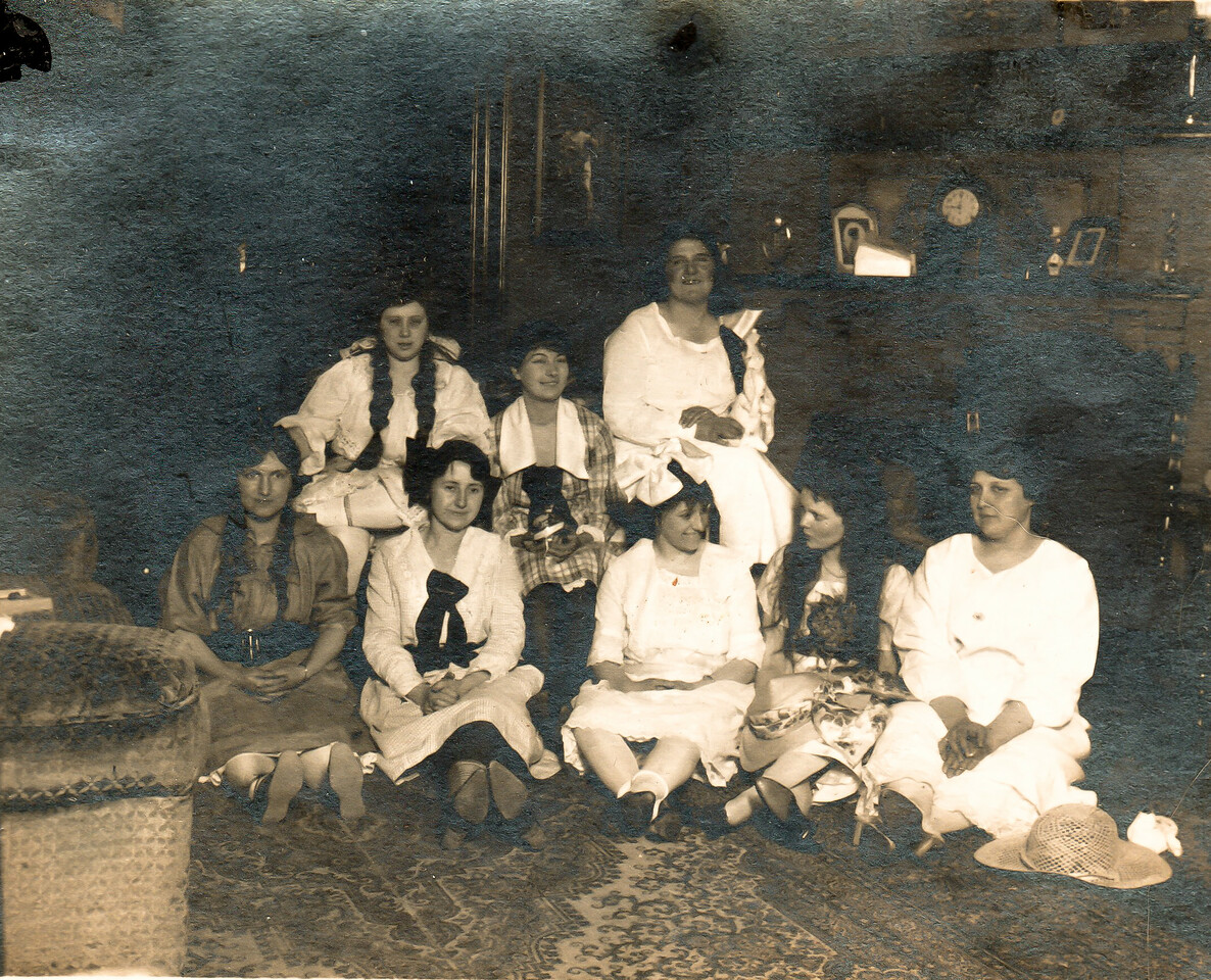 Betty Beach is sitting on the far right in the front row.